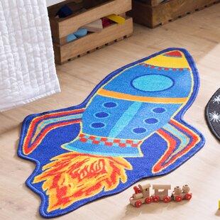 Isabella Rocket Blue Rug by Zoomie Kids