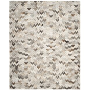 d092ce548dd Stasia Hand-Woven Natural cowhide Area Rug