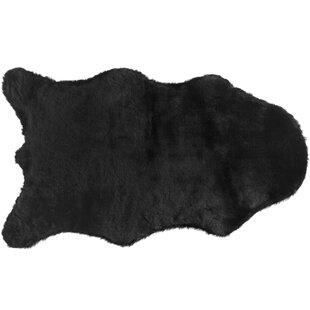 Quintero Faux Rabbit Fur Black Area Rug