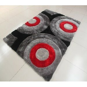 Kishor Circle Black/Gray Area Rug