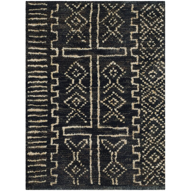 Sarvis Hand Knotted Black Cream Area Rug