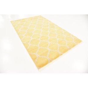 Moore Yellow Area Rug