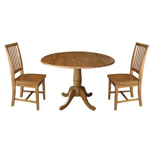 Montville Round Top Pedestal Extending 3 Piece Drop Leaf Solid Wood Dining Set