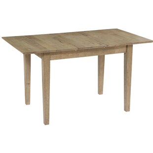 Janiyah Butterfly Extendable Solid Wood Dining Table