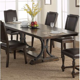 Keshia Pedestal Extendable Dining Table
