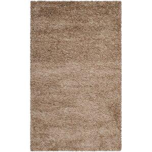 holliday brown area rug