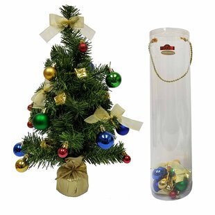 green artificial christmas tree with decoration kit