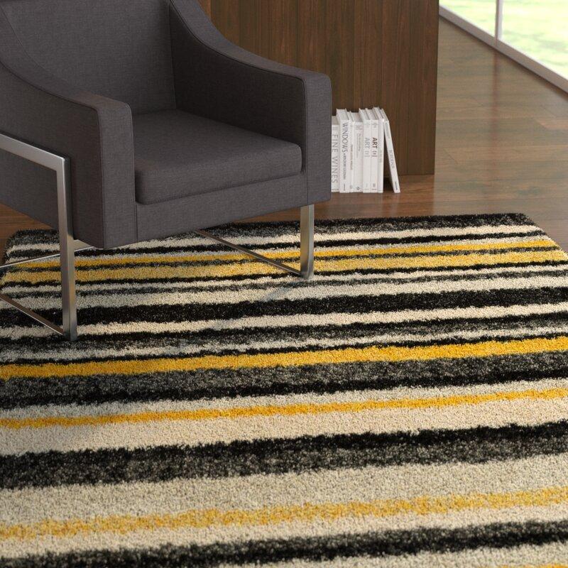 Nalder Black Yellow Area Rug