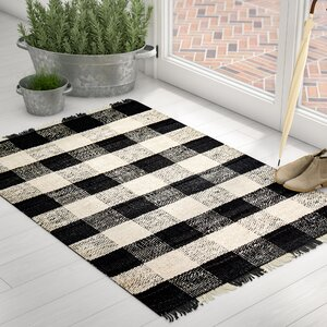Buy Sauget Hand-Woven Black/Ivory Area Rug!
