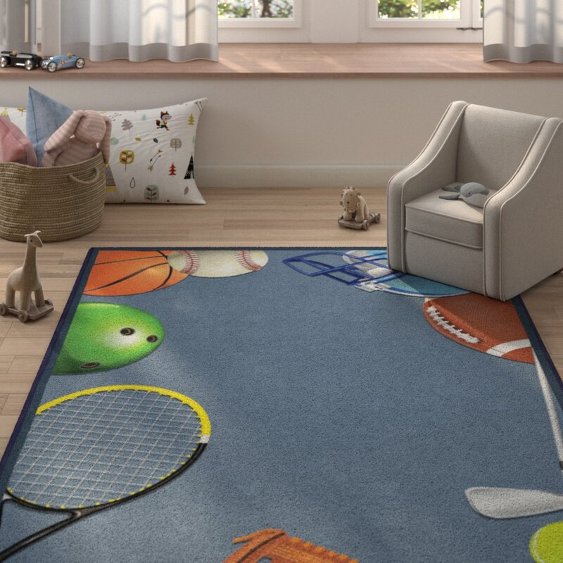 Zoomie Kids Camellia Sports Play Ball Blue Area Rug, Size: Rectangle 76 x 10