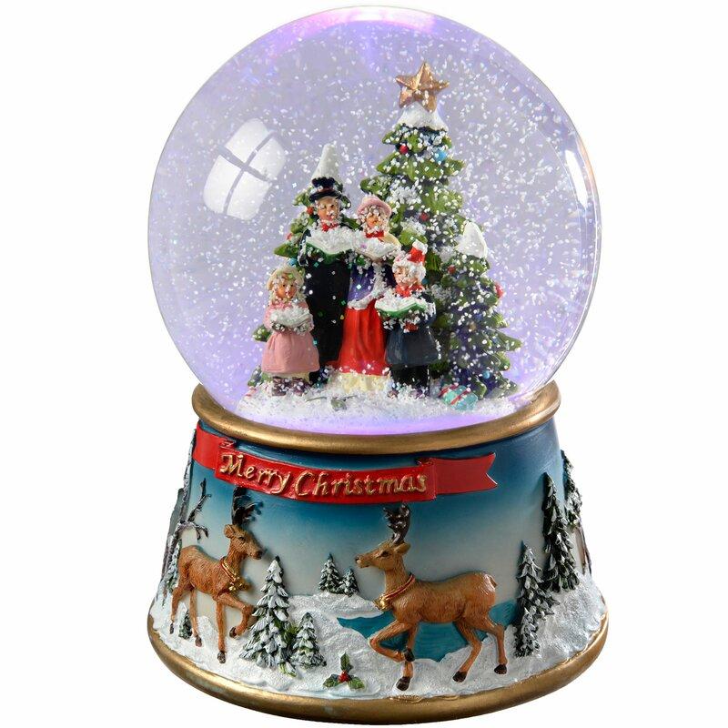 The Seasonal Aisle Carol Singer Colour Changing Snow Globe ...