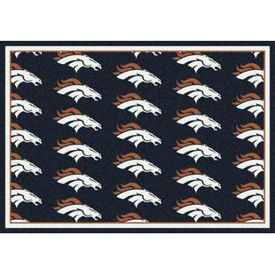 NFL Team Repeat Football Indoor/Outdoor Area Rug