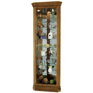 Dominic Lighted Corner Curio Cabinet by Howard Miller?