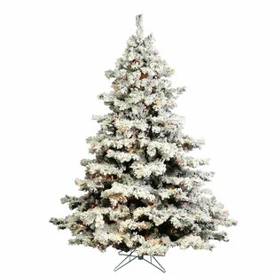 flocked alaskan white pine artificial christmas tree multi colored lights