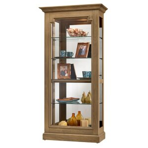 Caden Lighted Curio Cabinet by Howard Mil..