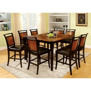 Woolum 9 Piece Counter Height Solid Wood Dining Set