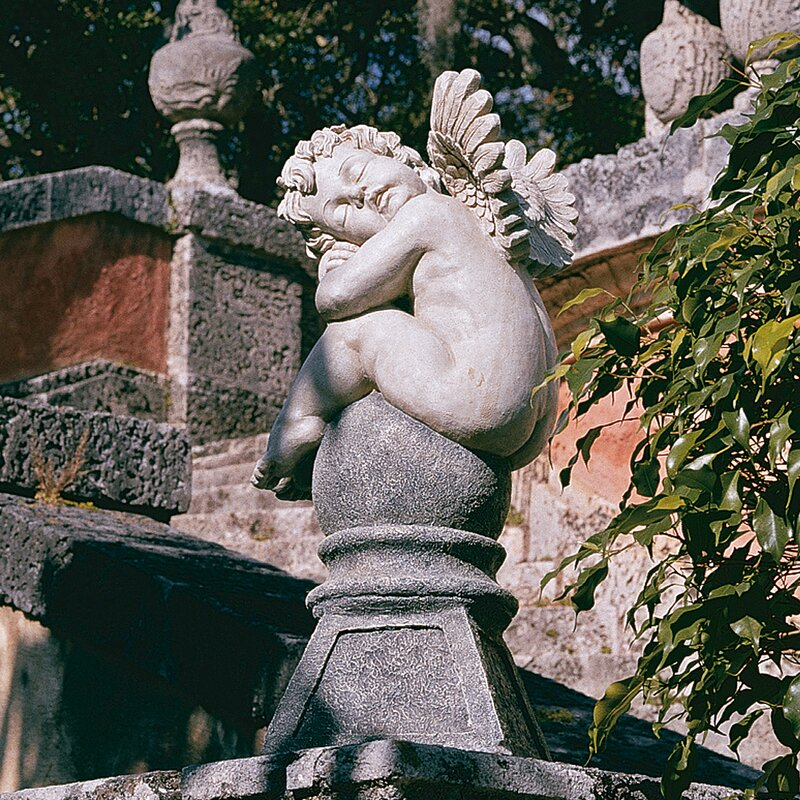 Balancing A Dream Cherub Garden Statue