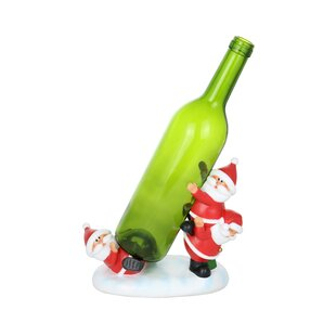Tumbling Trio of Santa Clauses 1 Bottle Tabletop Wine Rack