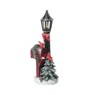 led resin cardinal with lamp post by the holiday aisle