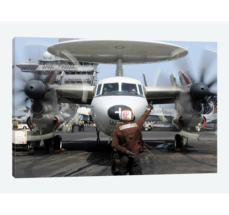 'Aviation Electronics Technician Directs an E-2C Hawkeye to Start Its  Engines' Photographic Print on Canvas
