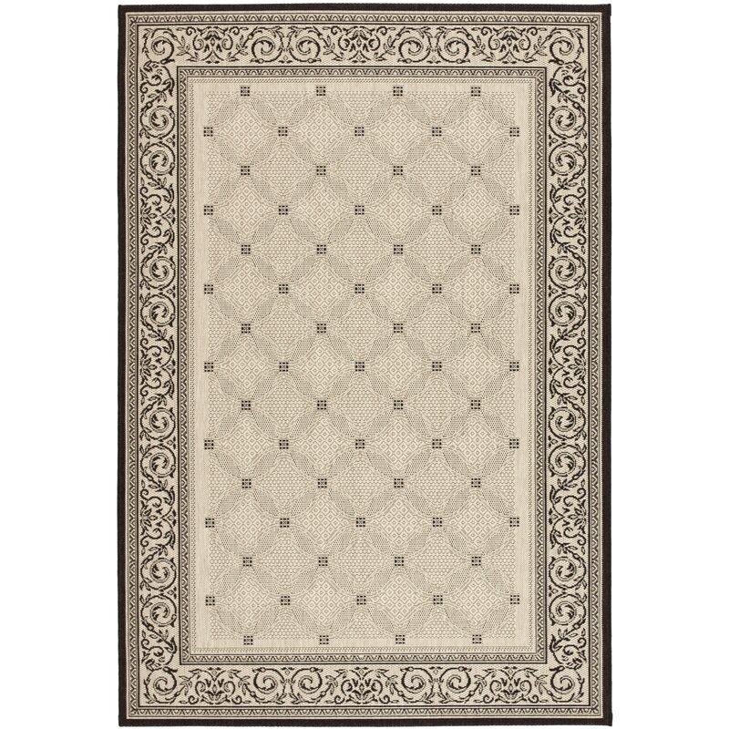Beasley Ivory Black Border Outdoor Rug