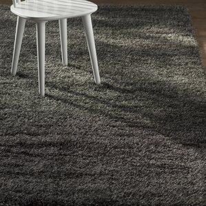 mayson black area rug