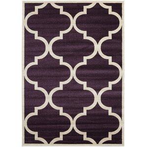 moore dark purple area rug