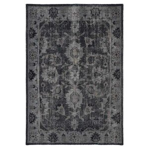 Deol Black Area Rug