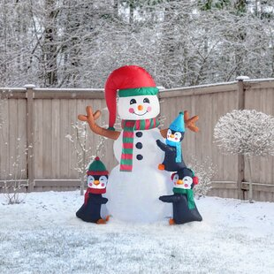 6 christmas inflatable penguins building snowman