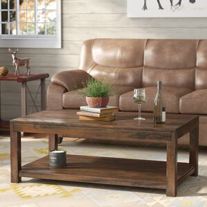 Cattle Creek Coffee Table with Magazine Rack by Loon Peak