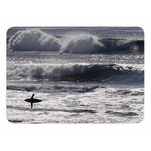 Lone Surfer by Nick Nareshni Bath Mat