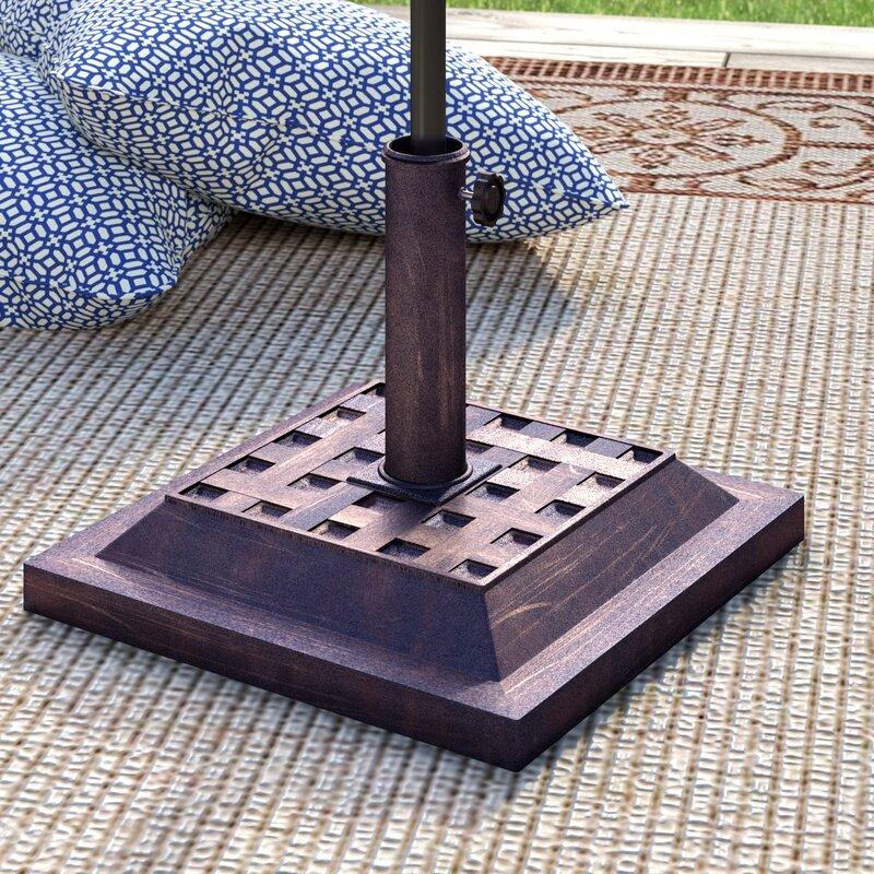 Umbrella Stand Definition: Charlton Home Nordham Cast Stone Free Standing Umbrella
