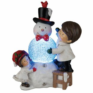 Light up outdoor snowman wayfair light up children with snowman figurine mozeypictures Choice Image