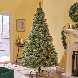 9 green spruce artificial christmas tree with 1150 clear lights