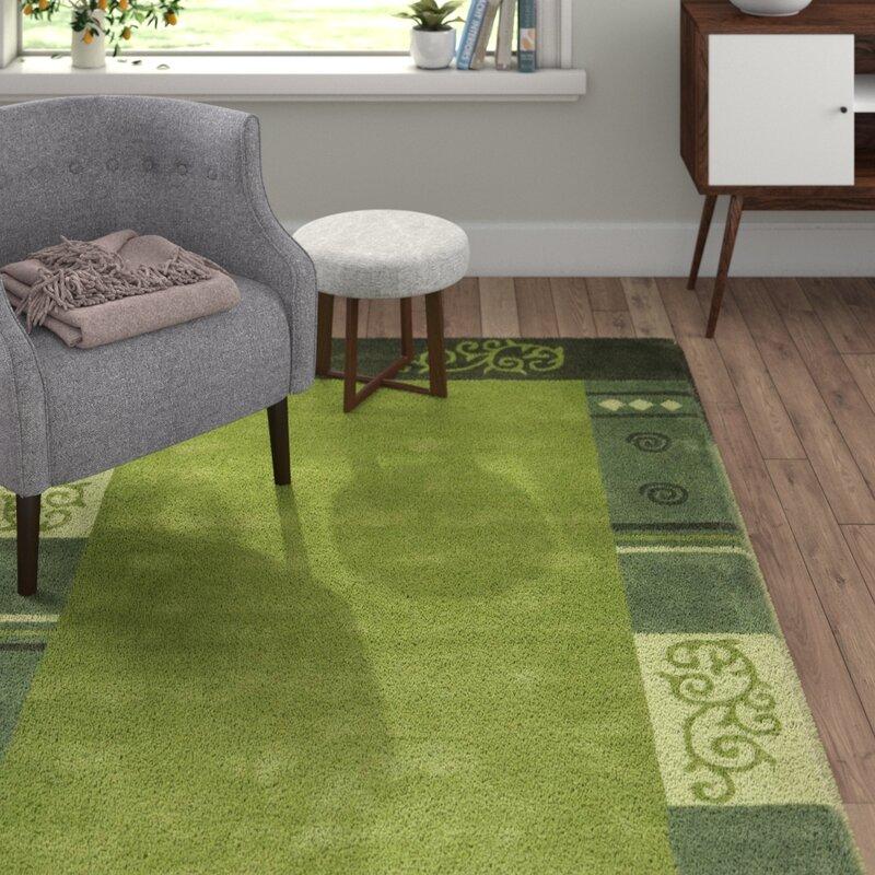 theko handgefertigter teppich ambadi aus wolle in gr n bewertungen. Black Bedroom Furniture Sets. Home Design Ideas