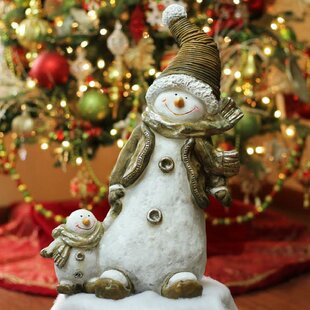 cd912f4f6fd39 Whimsical Snowshoeing Ceramic Christmas Snowman with Snow-Baby Tabletop  Figure