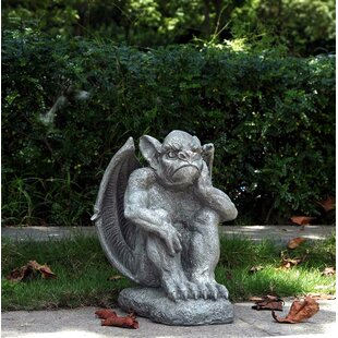 Gargoyle Sitting With Hand On Face Statue