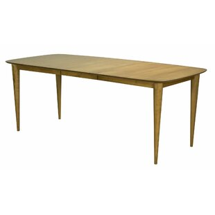 Couey Extendable Solid Wood Dining Table