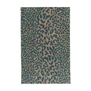 Macias Teal Animal Print Area Rug