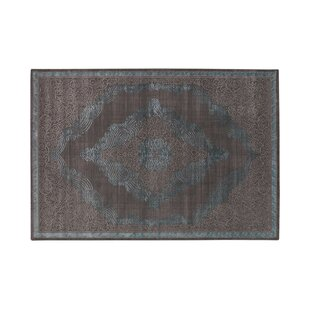 Kellie Tufted Brown Rug by World Menagerie