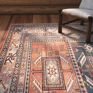Ovid Orange Area Rug