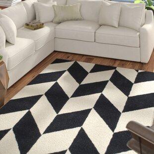 Rummel Hand Tufted Black/White Indoor Area Rug