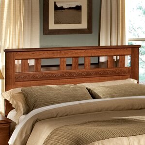 ... Wooden headboard adds warmth to the contemporary bedroom [Design:  Carriage Lane Design-Build
