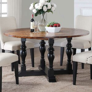 Maryellen Round Extendable Dining Table b..