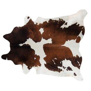 Handmade chocolate/White Area Rug Pergamino