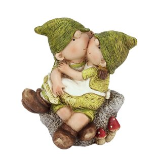 Young Boy And Girl Gnomes Sitting On A Stone Garden Statue
