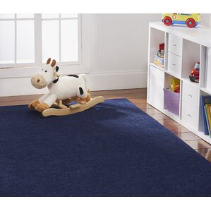 cara navy blue area rug