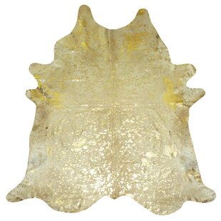 https://secure.img2-fg.wfcdn.com/im/69009789/resize-h310-w310%5Ecompr-r85/1467/14675959/extra-large-brazilian-cowhide-gold-area-rug.jpg