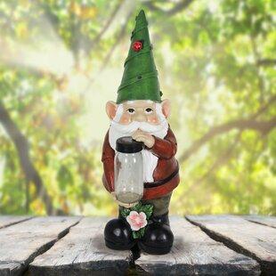solar gnome holding firefly lantern statue
