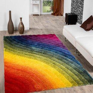 89b7daed25 Ainsley Soft 3D Wavy Rainbow Area Rug